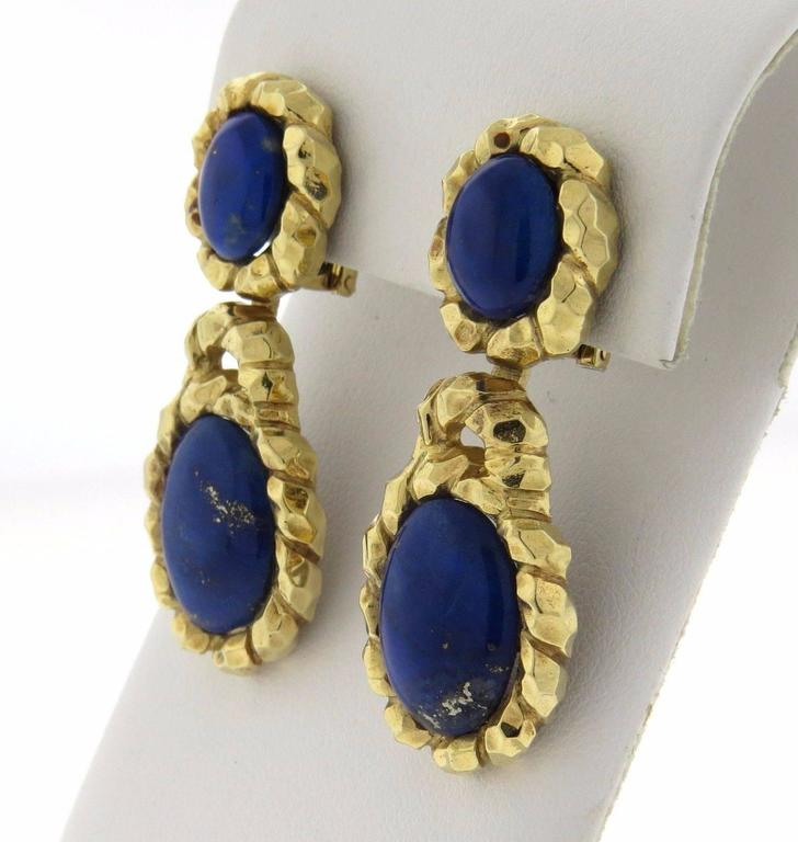 A pair of 18K yellow gold earrings set with lapis.  The earrings measure 48mm long x 19mm and weigh 24.7 grams.  Marked: Wander France, Backs are marked 14K. Earrings tested 18K.