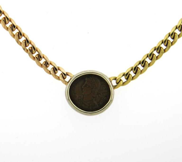 An 18k yellow rose and white gold necklace set with an ancient coin.  The necklace is 16 1/8