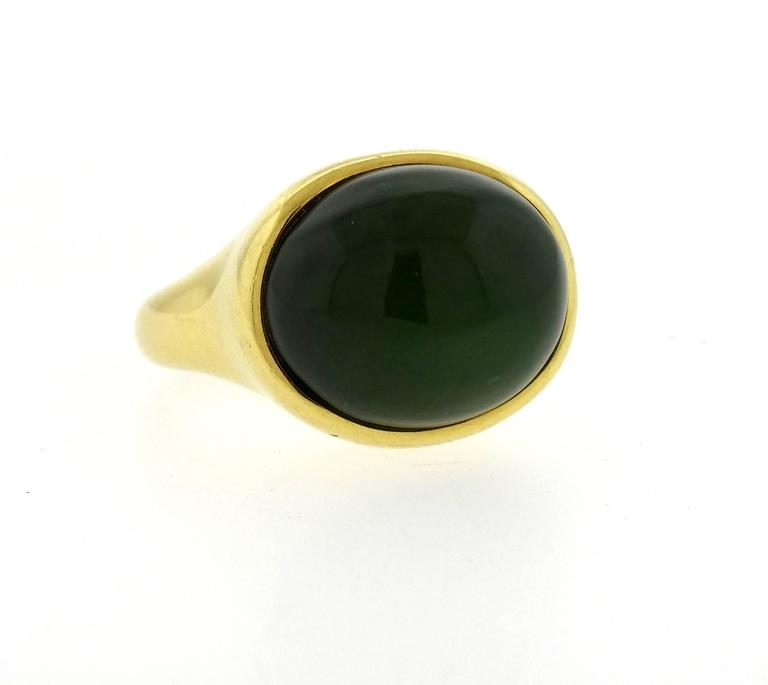 Large 18k yellow gold ring, crafted by Elsa Peretti, featuring 17mm x 19.5mm  jade cabochon. Ring size - 7, ring top is 18mm x 21mm, sits approx. 16mm from the finger . Marked: Tiffany 7 Co, Elsa Peretti, 750, Hong Kong. Weight - 22.9 grams