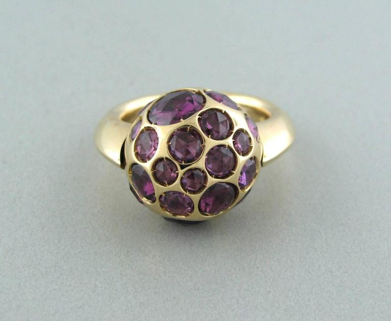 Pomellato 18k gold ring crafted for the Harem collection. Features rhodolite and garnet. Ring top measures 17mm in diameter. Marked 750, Pomellato. Weight-19.8 grams. Ring size 6.5. Ring retails for $7170.