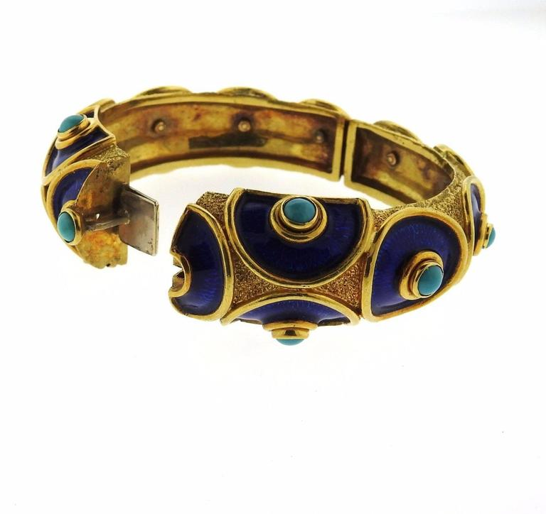 An 18k yellow gold bracelet set with turquoise and blue enamel. The bangle will comfortably fit up to a 7