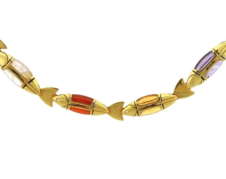 "An 18k yellow gold necklace set with multicolor gemstones and diamonds.  The necklace is 19"" long and 10mm wide.  The weight of the piece is 85.9 grams.  Marked: Cleto Munari, 750, Italian mark."