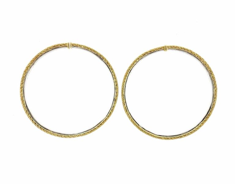 A pair of 18k yellow gold hoop earrings by Buccellati.  The earrings are 52mm in diameter and 3.7mm wide.  The earrings weigh 34.4 grams. Marked: Buccellati, 18kt, Italy. The retail is $11,320.