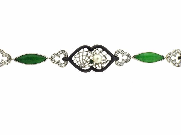 A 14K gold and oxidized steel beacelet set with jadeite, a 5.2mm pearl and approximately 1.40ctw of H/VS diamonds.  The bracelet is 7 3/4