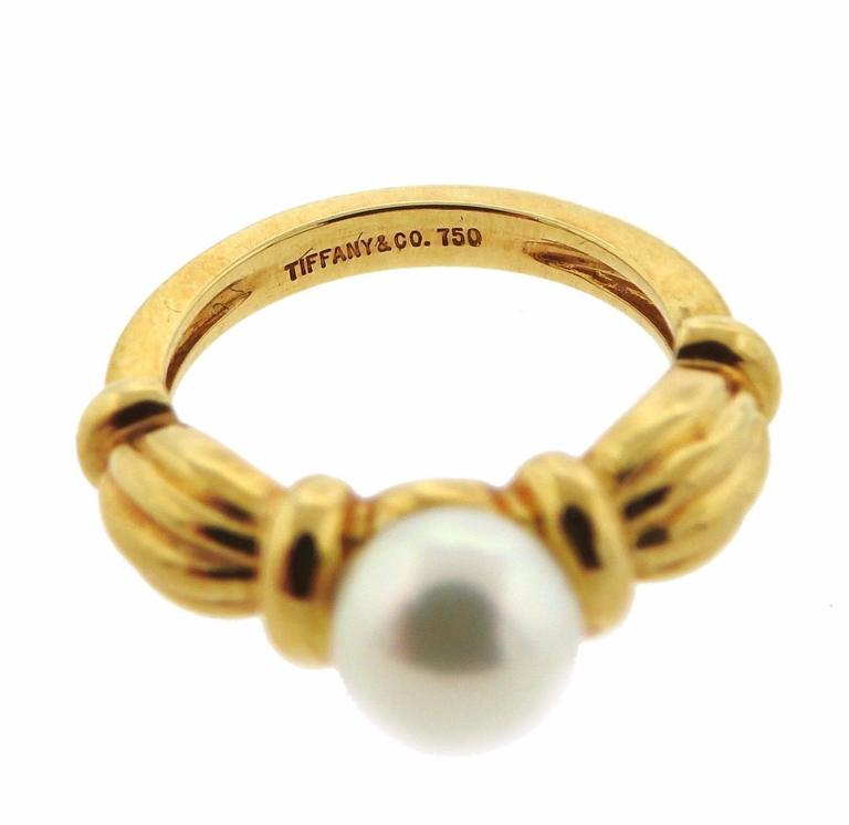 An 18k yellow gold ring set with a 7.3mm pearl.  The ring is a size 4.5 and weighs 5.9 grams.  Marked: Tiffany & Co. 750.