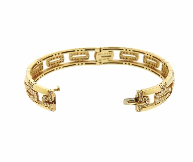 An 18K gold bracelet set with approximately 1.99 ctw of F-G/VVS-VS diamonds.  The bracelet will comfortably fit 6.75