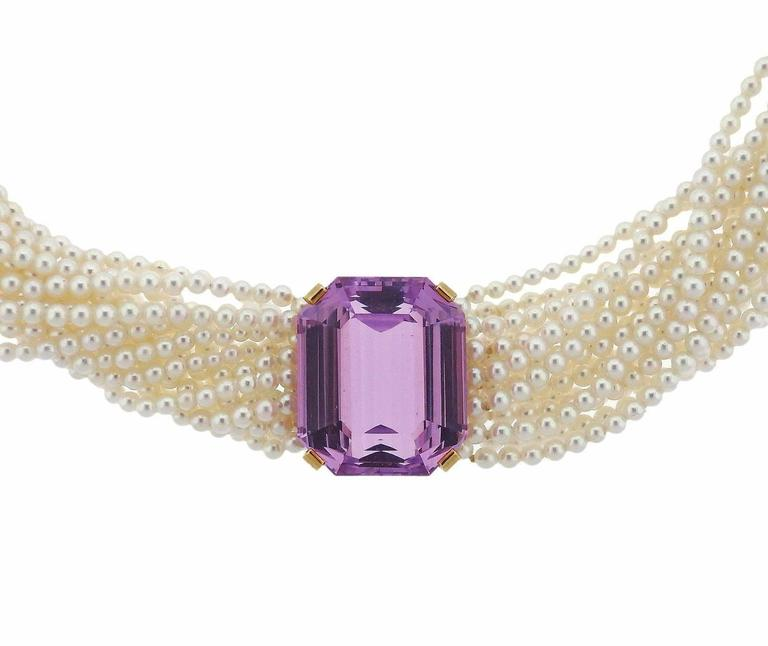 An 18k gold torsade necklace set with 2,5mm pearls and a kunzite measuring 20.8mm x 17.5mm.  The necklace is 13