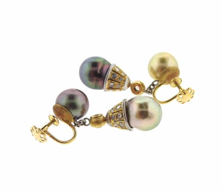 A pair of 18k gold earrings set with 11 - 11.5mm pearls and rose cut diamonds.  The earrings measure 44mm x 11.5mm and weigh 16.1 grams.  Marked:Gianmaria Buccellati 18KT Italy 750.  The retail is $13380.