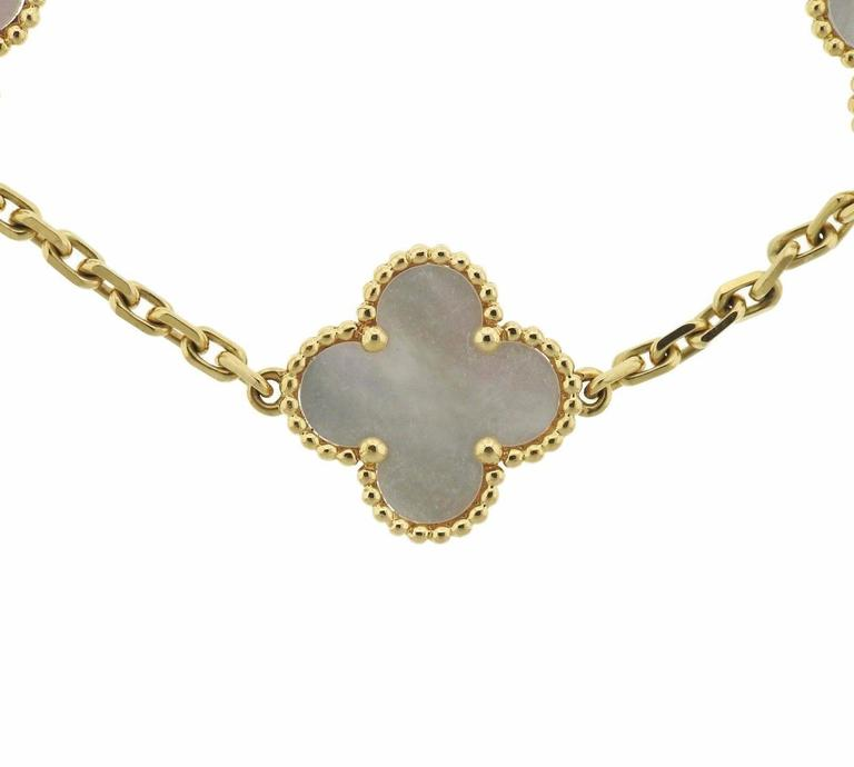 Van Cleef & Arpels Vintage Alhambra Gold Mother of Pearl 5 Motif Bracelet In Excellent Condition In Boca Raton, FL