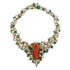 1970s Barbara Anton Carved Emerald Coral Diamond Pearl Gold Necklace