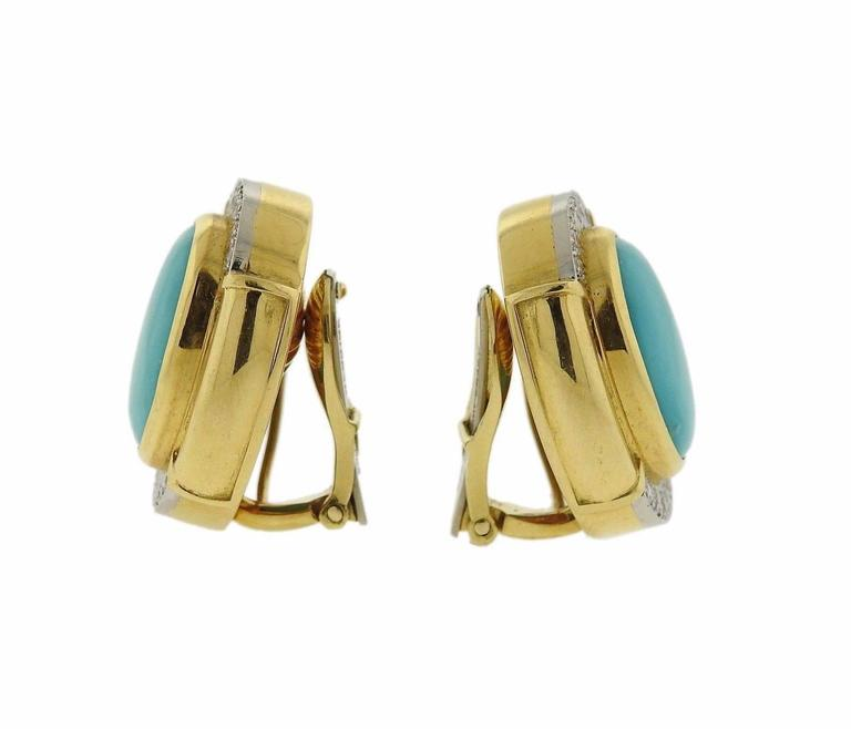 A pair of 18k gold and platinum earrings set with turquoise (16mm x 12mm) and approximately 0.48ctw of H/VS diamonds.  The earrings measure 25mm x 20mm and weigh 30.3 grams.  Marked: 900pt, 18k, Webb.