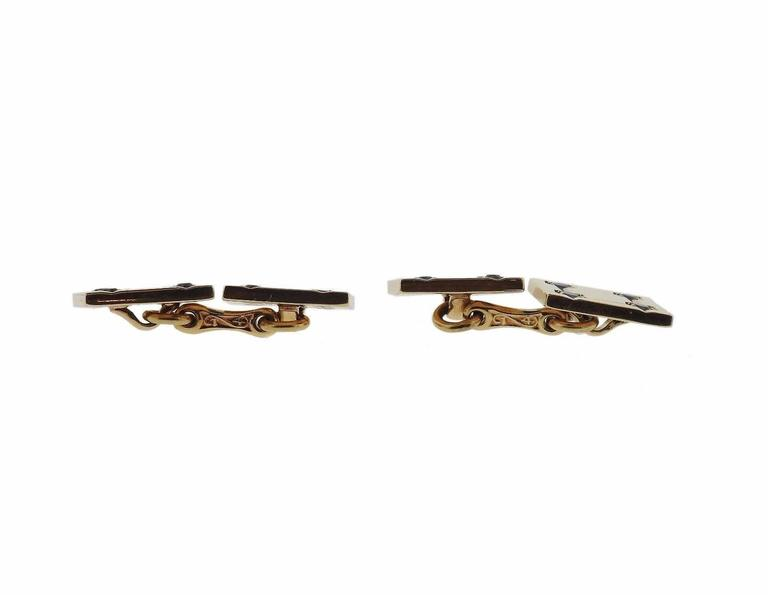 A pair of 14k yellow gold cufflinks set with sapphires.  The cufflinks measure 12.5mm x 12.5mm and weigh 13.7 grams.  Marked: 14k, Tiffany & Co.