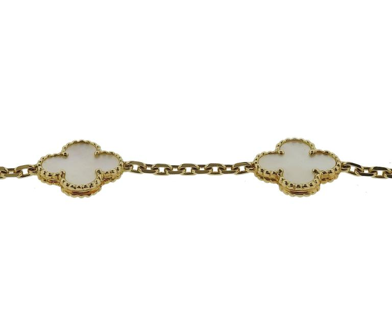 "An 18k gold bracelet, crafted by Van Cleef & Arpels for iconic Alhambra collection, featuring 5 mother of pearl clover motifs. Bracelet is 7 1/4"" long, clovers measure 15mm x 15mm and weighs 11.2 grams. Marked: CL29486, VCA. Retail $3650"