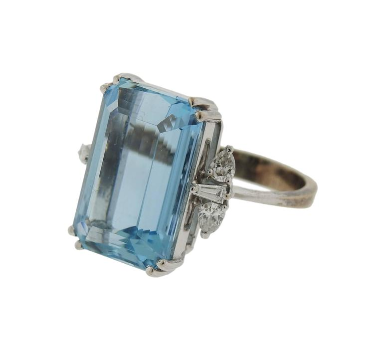 An 18k white gold ring, crafted by H. Stern, featuring approximately 14ct aquamarine, surrounded with 0.58ctw in diamonds. Ring size 7 , weighs 9.8 grams. Marked: S mark, 58, 750