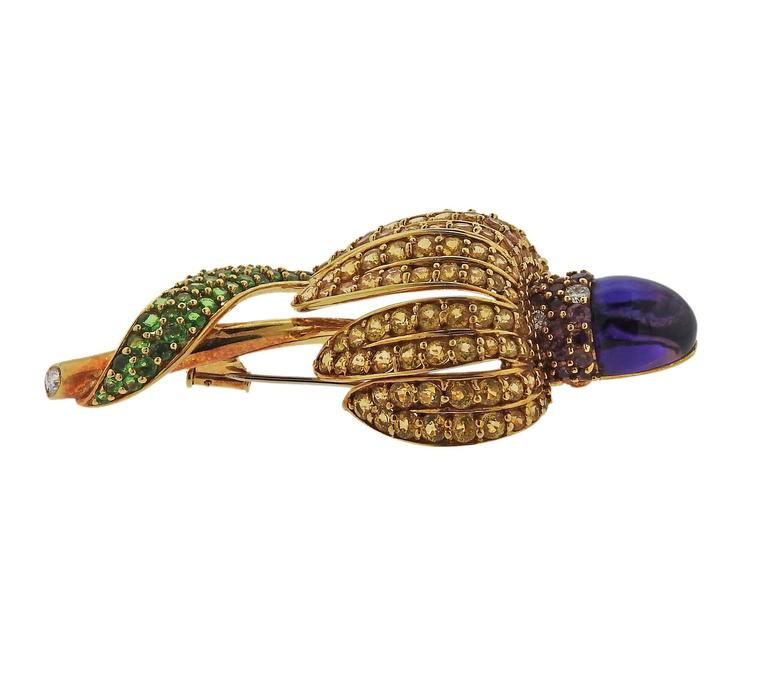 Colorful 18k yellow gold brooch and earrings set, crafted in circa 1983 by Tiffany & Co, decorated with tsavorites, amethyst cabochons, yellow and pink sapphires, approximately 0.60ctw in G/VS diamonds. Brooch is 75mm x 37mm, earrings measure