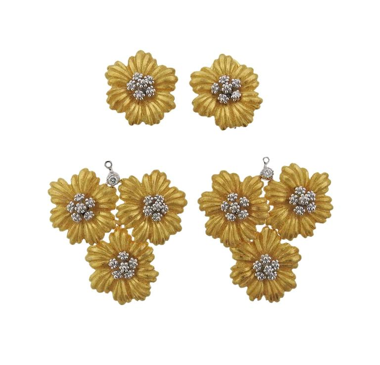 18K Gold Buccellati pair of earrings featuring a floral motif decorated with diamonds. Earrings are day/night and can be worn full length or as just the tops. Earrings measure 55mm x 36mm. Without pendants earrings measure 20mm x 20mm. Marked