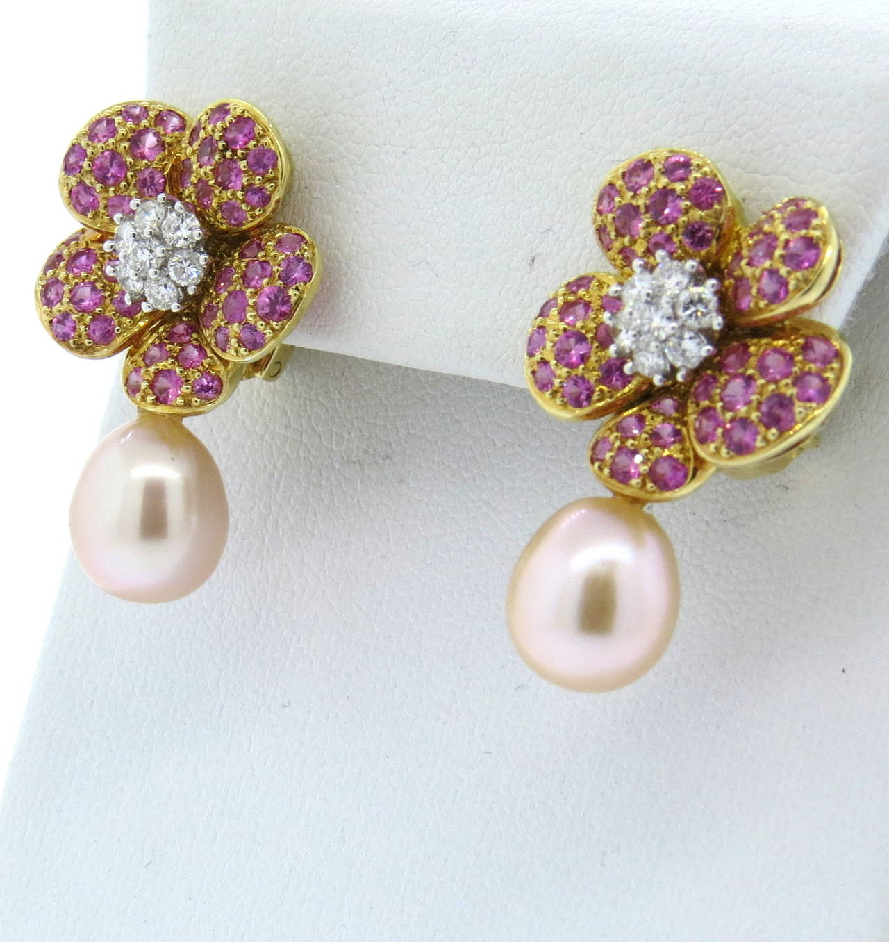 A Pair Of 18k Yellow Gold Earrings Set With Pink Shires Roximately 0 46ctw In