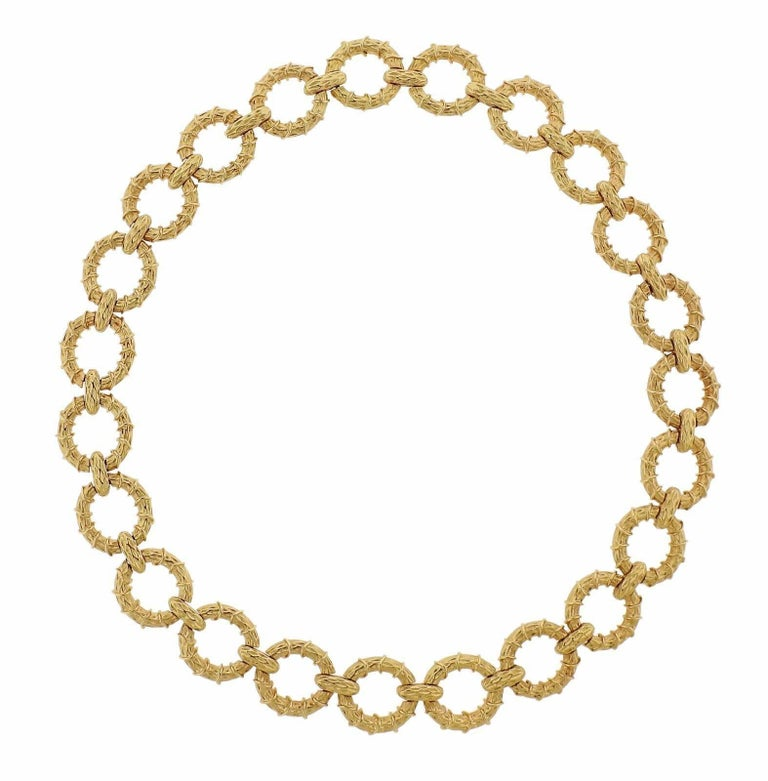 """An 18k yellow gold bracelet and necklace suite.  The necklace is 21"""" long (with two sets of extra removable links - 3""""each, on each side). Bracelet is 7 /4"""" long. Each piece is 20mm wide.  The weight of the set is 192 grams."""