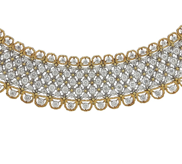 """Gorgeous 18k yellow and white gold necklace, crated by Buccellati, decorated with approximately 15 carats in diamonds. Necklace is 16"""" long and 22mm wide  , weighs 134.4 grams. Marked: Inventory scratch number, 18k, Italy, Buccellati."""