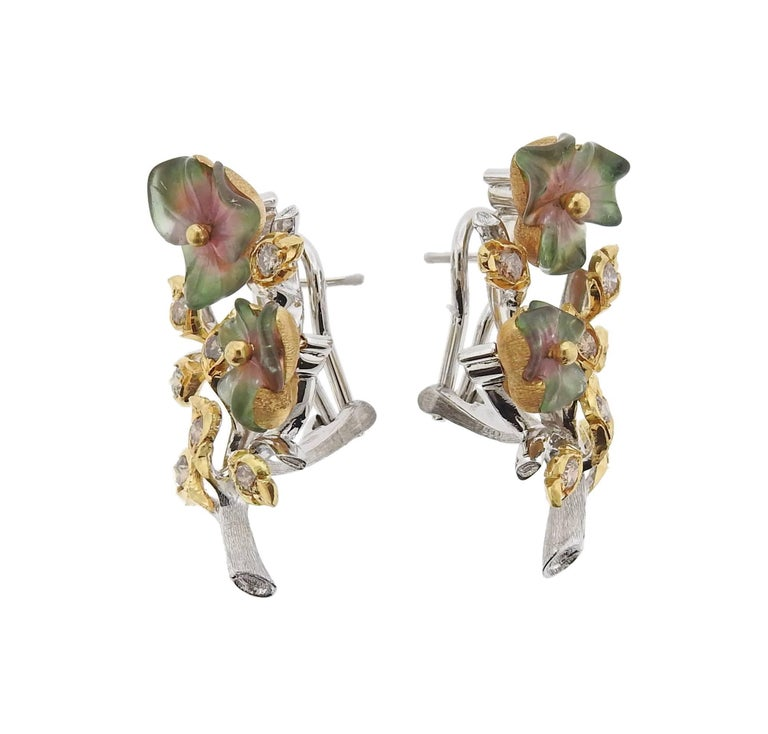 Pair of 18k yellow and white gold flower earrings, decorated with approximately 0.84ctw in diamonds and carved tourmalines. Earrings measure 34mm x 21mm. Marked: Buccellati, 18k, Italy. Weight - 19.4 grams. With pouch. Retail $23200.