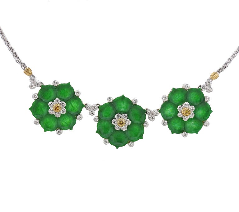 An 18k yellow and white gold necklace, crafted by Buccellati, featuring three flower pendants, decorated with carved jade and approximately 0.85ctw in diamonds. Necklace is 16 inches long, each flower measures 22mm x 24mm. Marked: Buccellati, 18k.