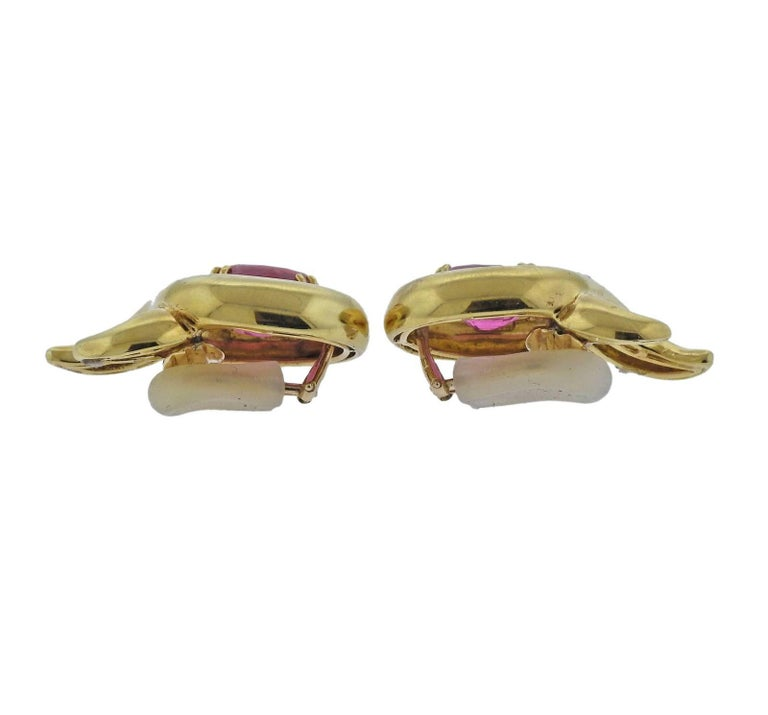 A pair of 18k gold earrings crafted by Verdura. Earrings feature pink tourmalines measuring 14.5mm x 11.2mm. Earrings measure Earrings are 36mm x 21mm and weigh 29.3 grams.
