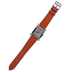 Hermès Stainless Steel H Hour Orange Band quartz Wristwatch Ref HH1.810