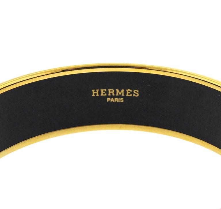 Iconic enamel bangle bracelet, crafted by Hermes, depicting penguins. Bracelet's inner diameter - 68mm, bracelet will fit approx.7