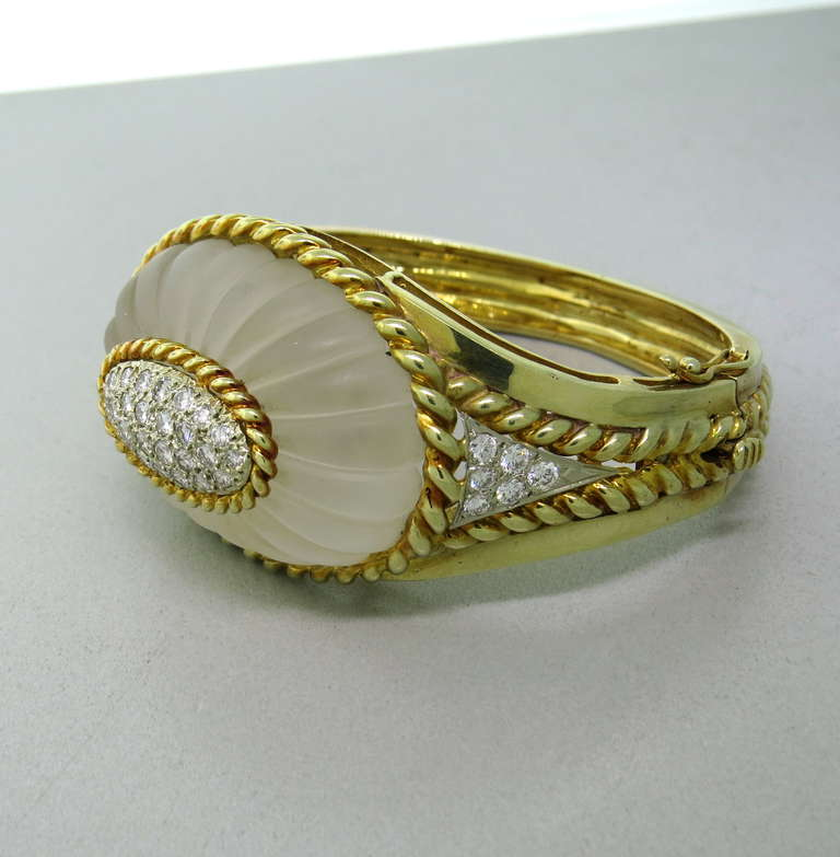 14k gold bracelet with carved frosted crystal and approx. 1.80ctw VS/GH diamonds. Bracelet will fit up to 7