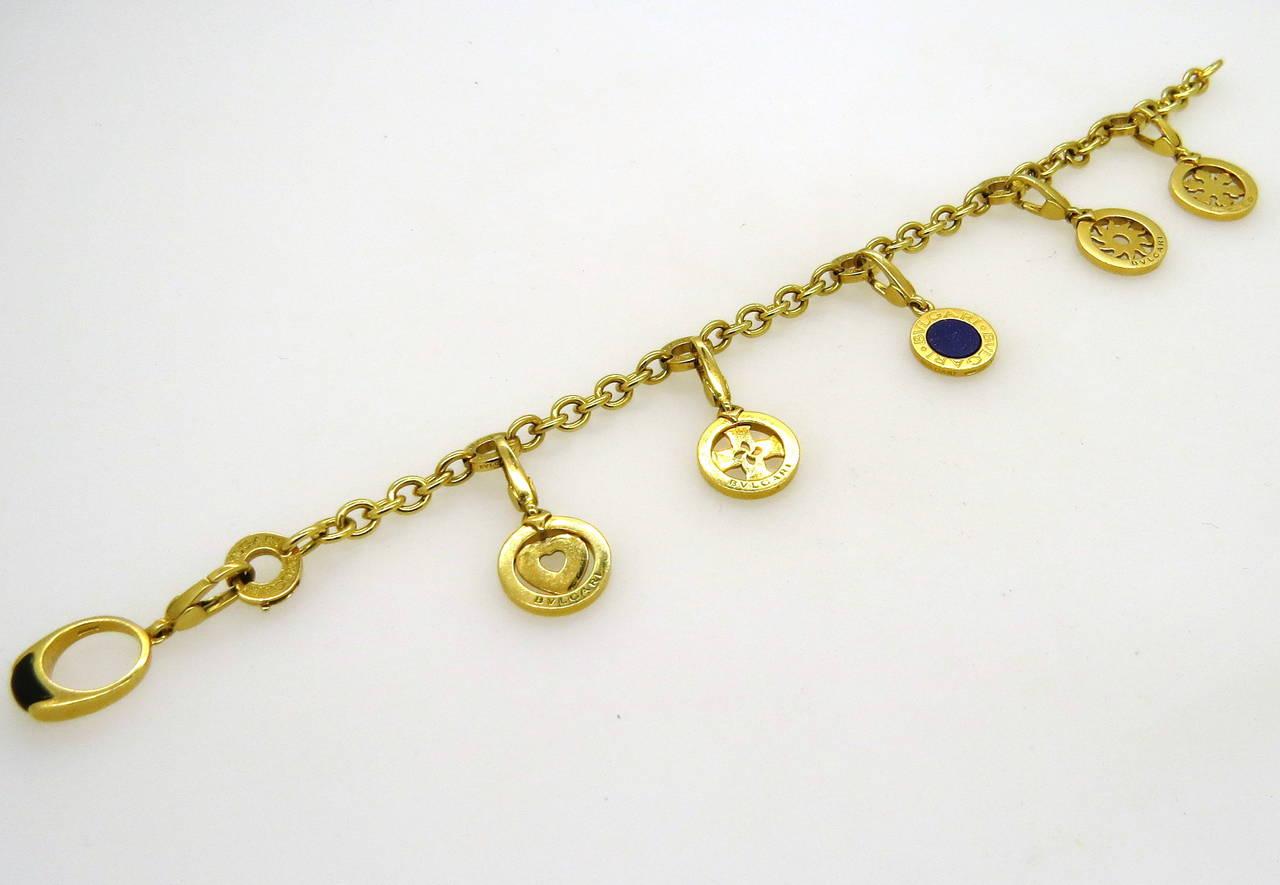 Classic Bulgari Onyx Lapis Gold Charm Bracelet For Sale at 1stdibs