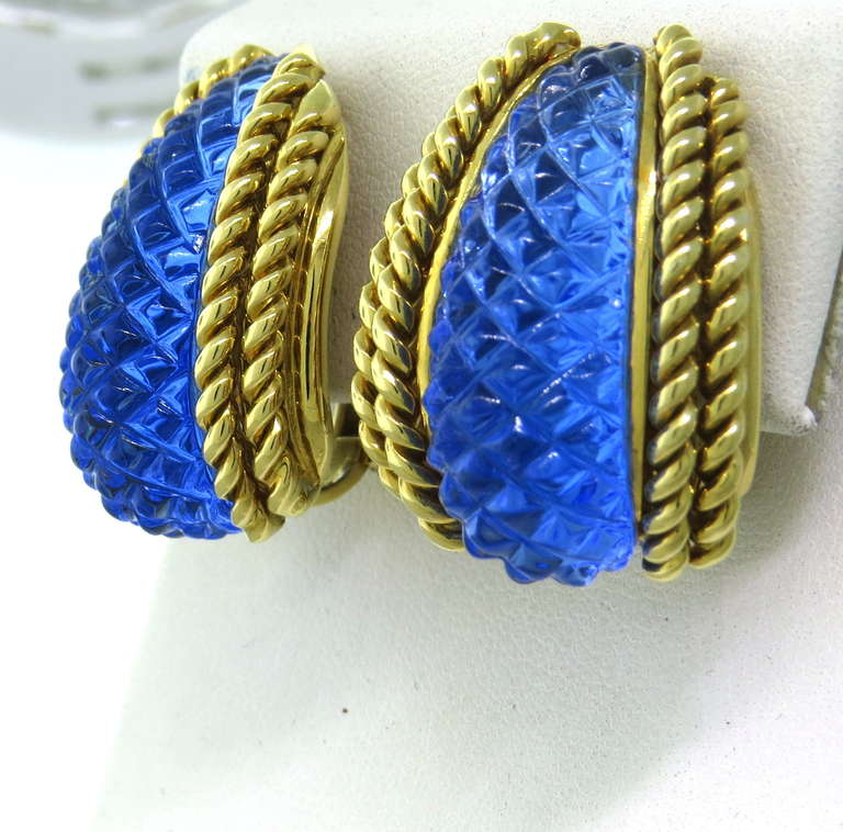 Metal: 18k Yellow Gold Gemstone: Blue Carved Crystal Dimensions: 23mm x 28mm Weight: 41.1g