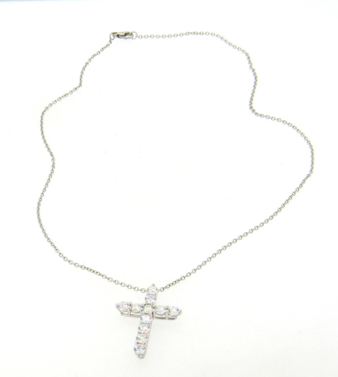 "A platinum cross pendant set with approximately 2.00ctw of VS/G-H diamonds on a 15"" chain.  The pendant measures 28mm x 21mm and weighs 7.6 grams with chain."