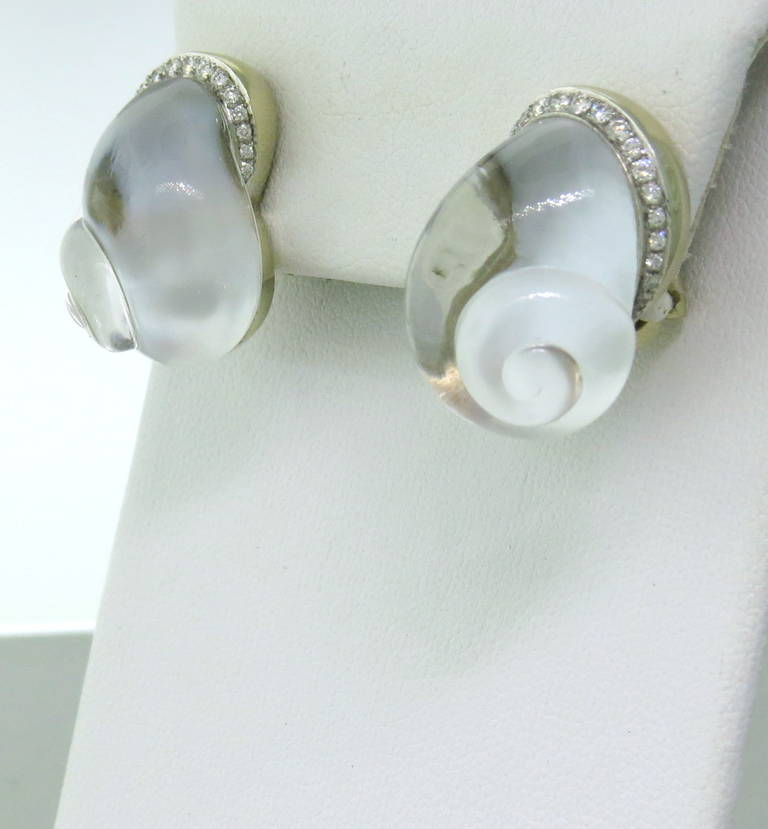 Delicate 18k gold earrings by Vhernier,featuring shell design in crystal, backed by mother of pearl and accented with diamonds. Earrings measure 23mm x 16mm. Marked Vhernier and 750. weight - 26.5 gr