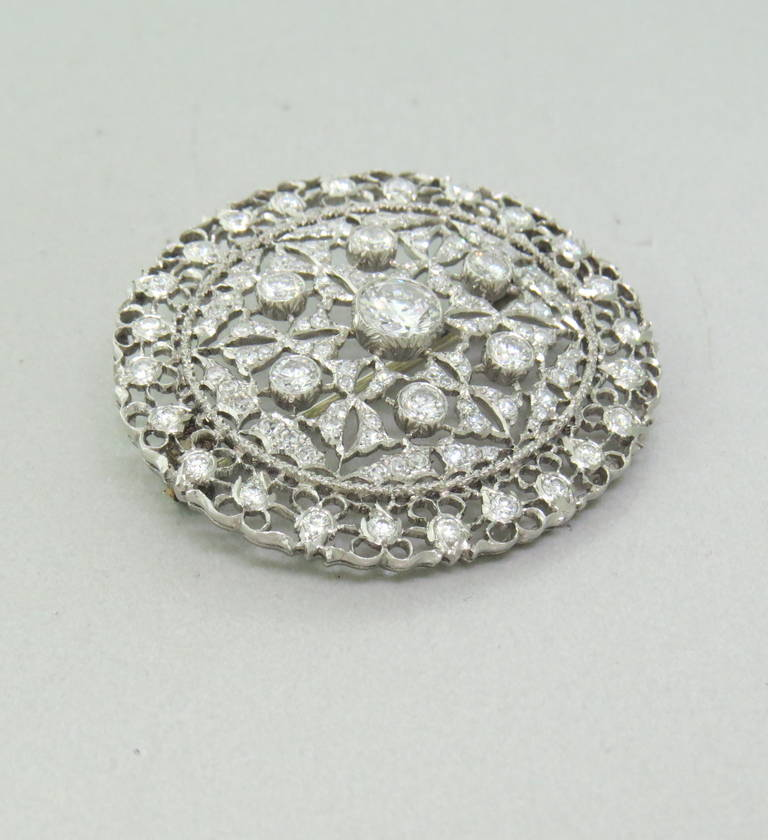 Majestic 18k White Gold convertible brooch / pendant.  Featuring approximately 2.50ctw in diamonds.  The pin measures 39mm x 35mm and weighs 12.5 grams.