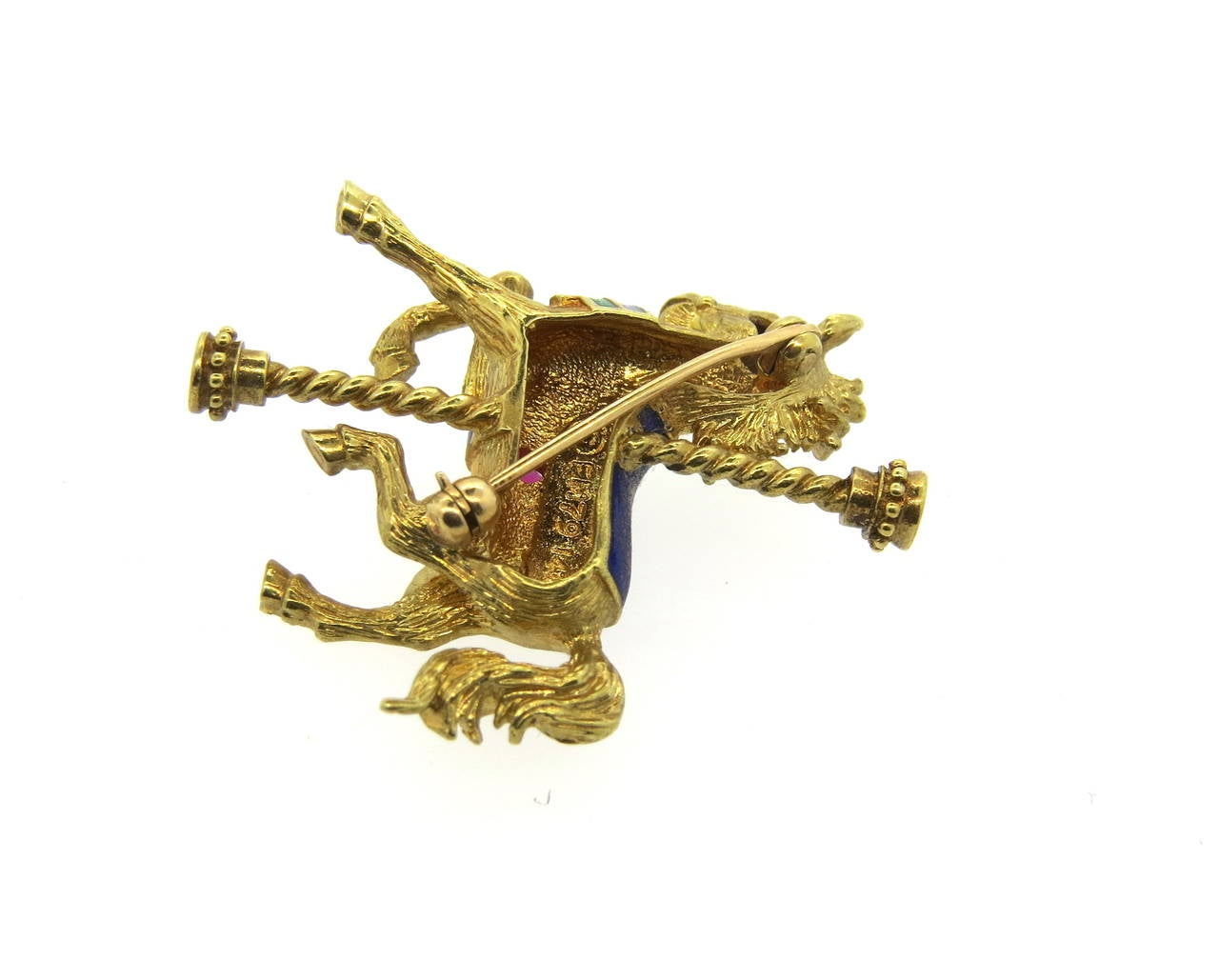1970s vintage 14k gold carousel brooch, depicting a horse, decorated with enamel and ruby. Brooch measures 30mm x 34mm. Weight of the piece - 9.4 grams