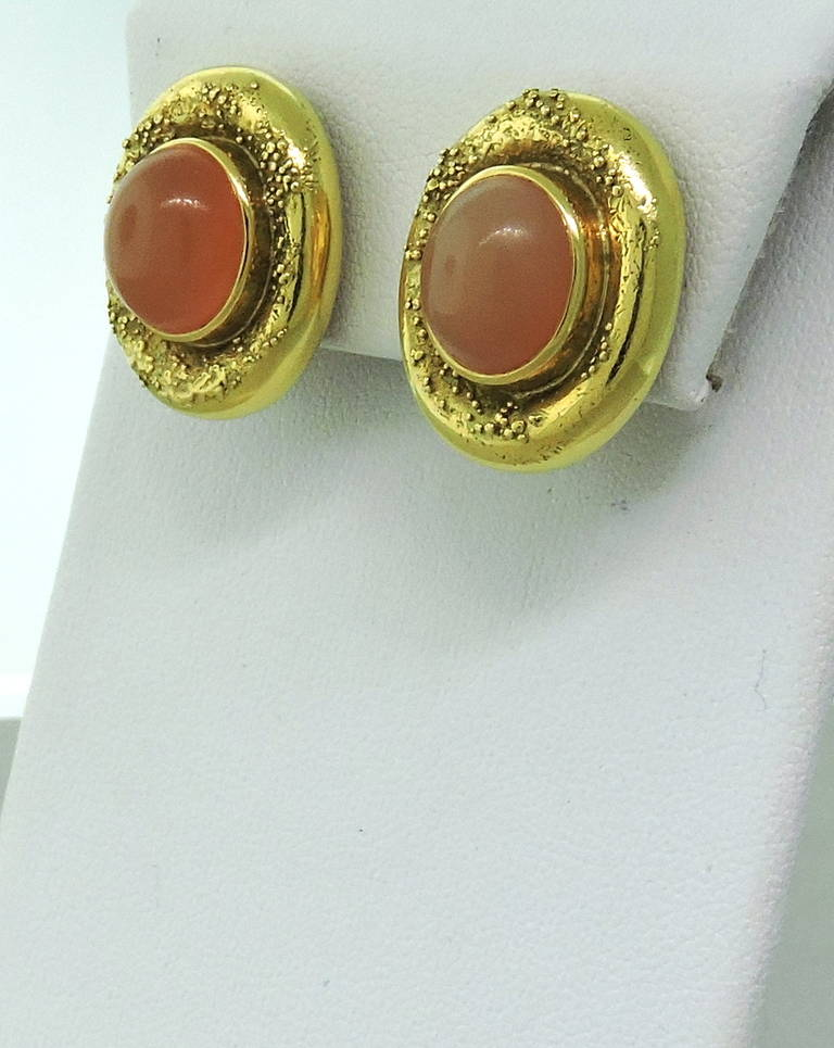 Stunning Elizabeth Gage 18K yellow gold earrings featuring peach moonstones. Earrings measure 22.3mm x 18.3mm. Marked Gage, English hallmarks. Weight - 28.0gr