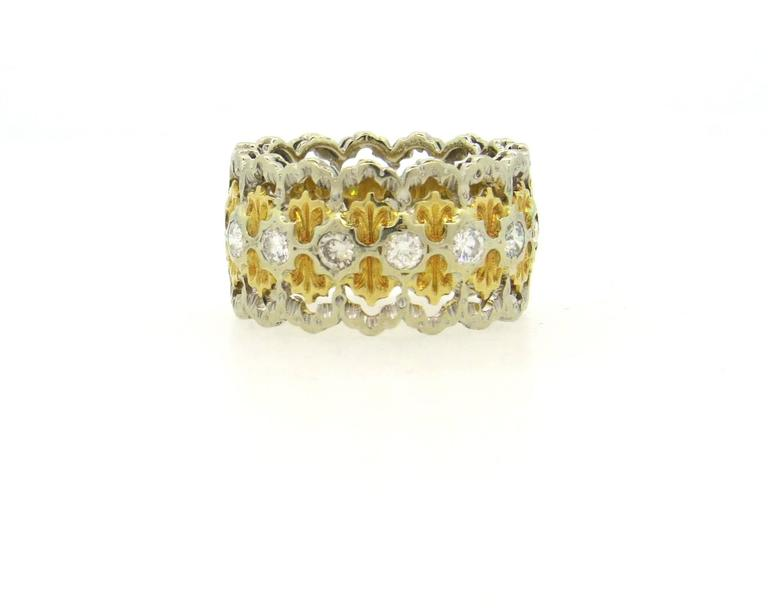 Vintage Buccellati band ring, set in 18k white and yellow gold, featuring approximately 0.56ctw in H/VS diamonds. Ring is a size 6 1/2, ring is 12mm wide.  Marked: Buccellati. Weight of the piece - 7.8 grams