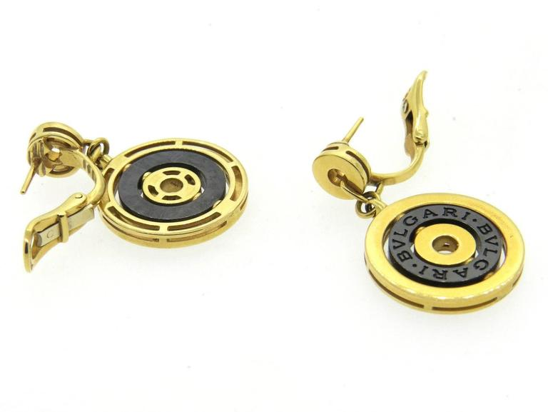 A pair of 18k yellow gold and black ceramic.  Crafted by Bulgari, the earrings are 35mm long x 21mm wide.  Marked: Bvlgari, 750, made in Italy.  The weight of the earrings is 21.7 grams.