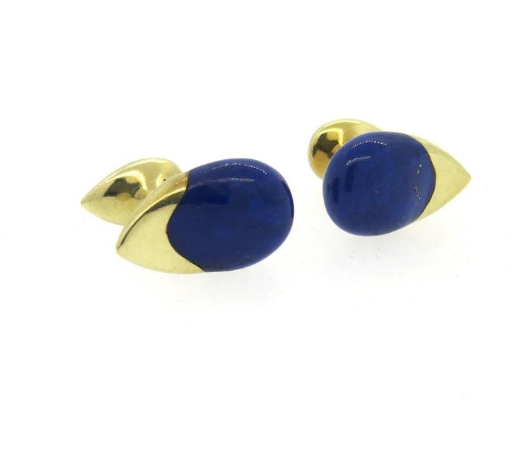 A pair 14k yellow gold cufflinks set with a lapis inlay. Each top measures 21mm x 13mm.  Marked: 14k, 585.  The weight of the cufflinks is 13.3 grams.
