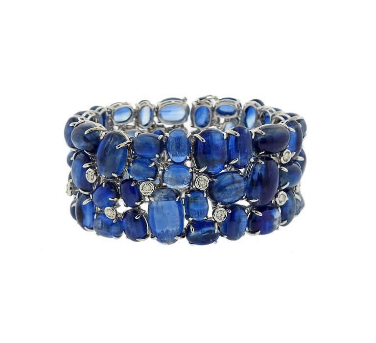 "18k white gold bracelet, featuring kyanite cabochons,adorned with approximately 0.80ctw in diamonds. Bracelet is 6 7/8"" long and 31mm wide . Marked: 750, 18k. Weight of the piece - 117.2 grams"