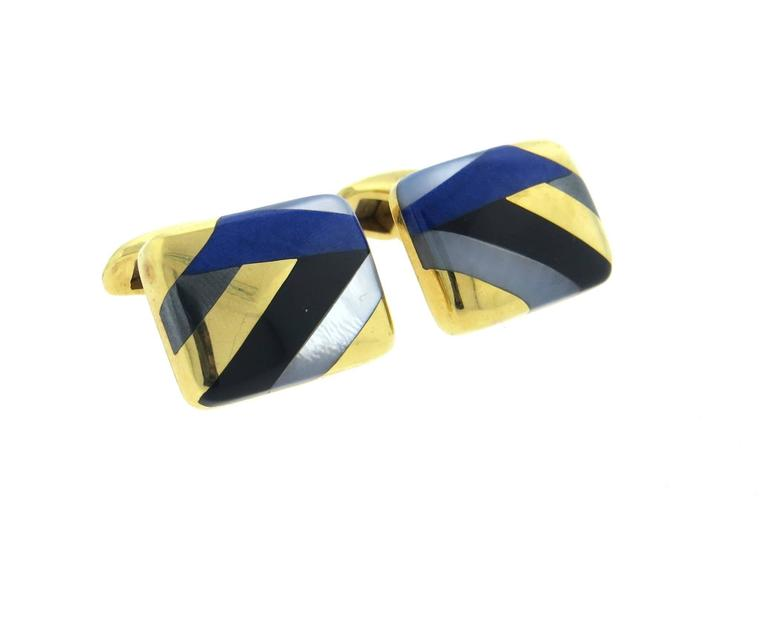 Large 18k yellow gold cufflinks, crafted by Asch Grossbardt, decorated with inlay mother of pearl, lapis lazuli and black onyx. Each top measures 21mm x 16mm. Marked AG 18k. Weight - 21.2 grams