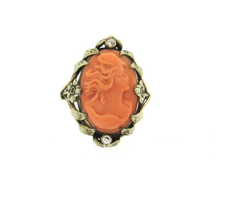 Antique 14k gold ring, set with 18mm x 12mm coral cameo as a centerpiece, surrounded with two diamonds. Ring is a size 5 1/2, ring top is 24mm x 18mm. Weight of the piece - 5.2 grams