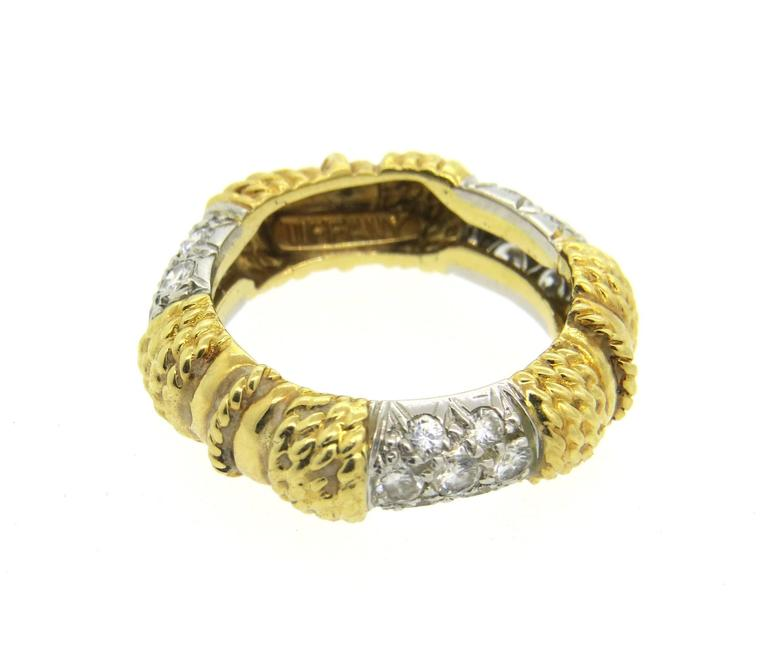 Vintage circa 1970s band ring, crafted by Tiffany & Co in  18k yellow gold, set with 3 sections encrusted with approximately 0.80ctw in G/VS diamonds. Ring is a size 6 and is 7.3mm wide. Marked 18k and Tiffany. Weight of the piece - 7.4 grams