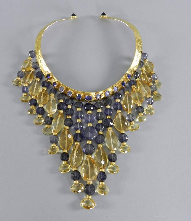 Eileen Coyne one of a kind 22k yellow gold hammered collar necklace.  Yellow and violet tourmaline fringe with 22k gold bead spacers. 13 violet faceted stones set on the base of the necklace and 16 graduated beaded strands extend from the collar.