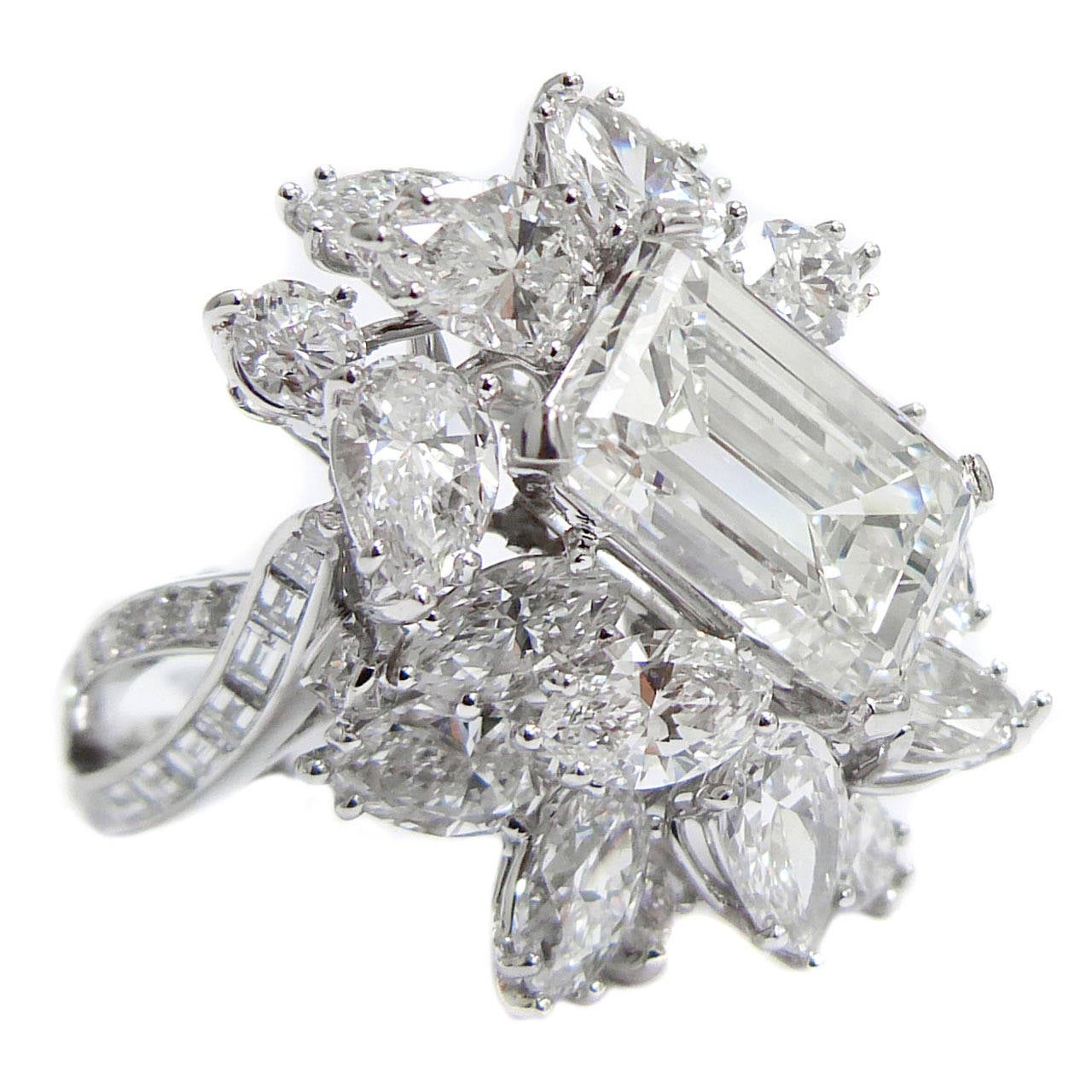 magnificent emerald cut platinum cluster ring for