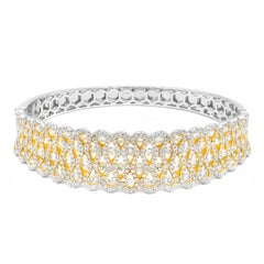Infinity Swirl Diamond Bangle Bracelet in White and Yellow Gold