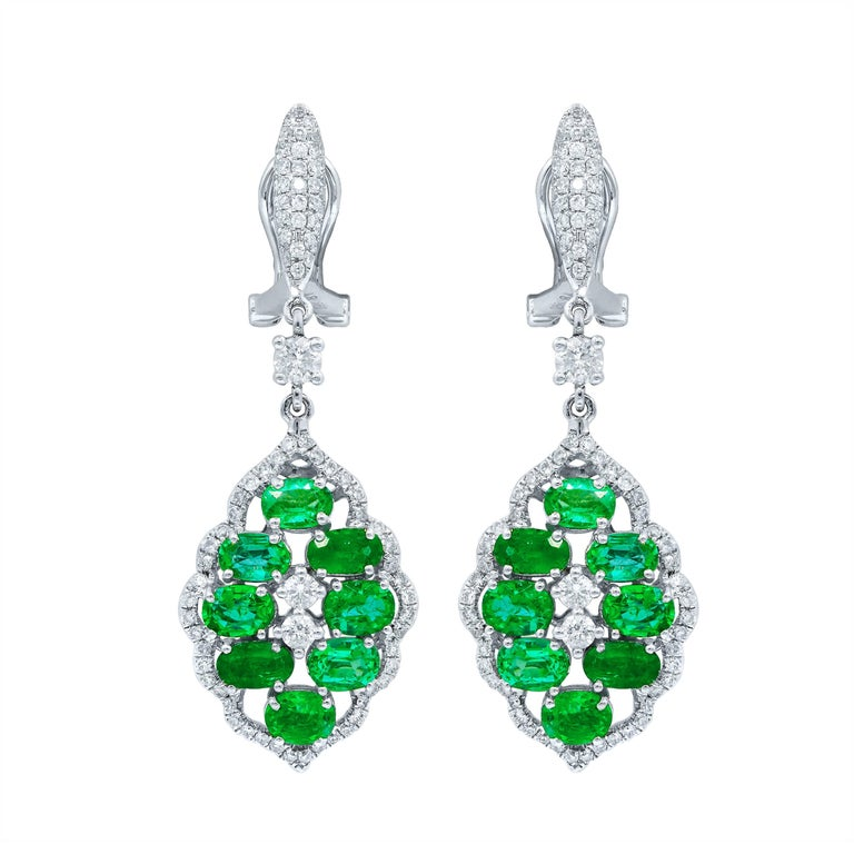 18 Karat White Gold, Diamond and Emerald Drop Design Earrings For Sale