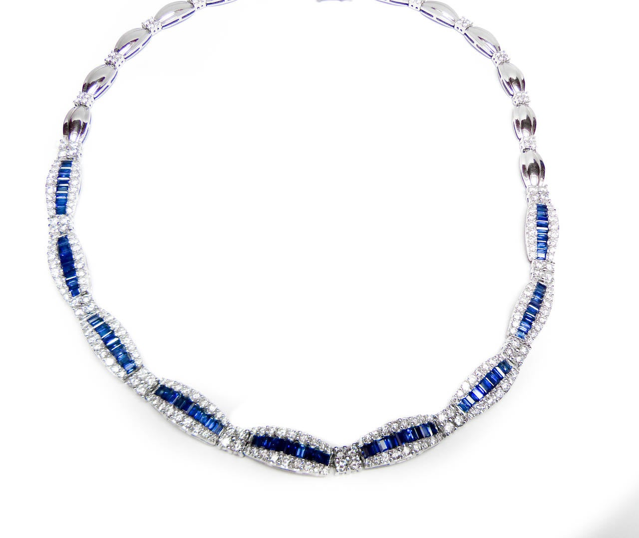 This beautiful sapphire and diamond necklace, features 8.50 Carats of sapphires and 10.00 Carats of diamonds