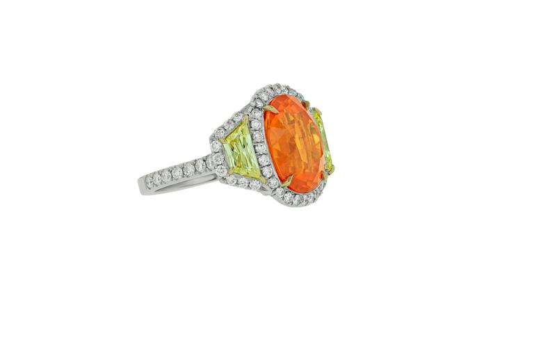 Platinum and 18KT custom designed Mandarin Garnet Ring, features finest quality mandarin garnet. The center stone is 13.20 carats Oval shaped Mandarin Garnet, the highest color and quality of Garnet.  Set with 1.50 Carats natural Fancy Yellow