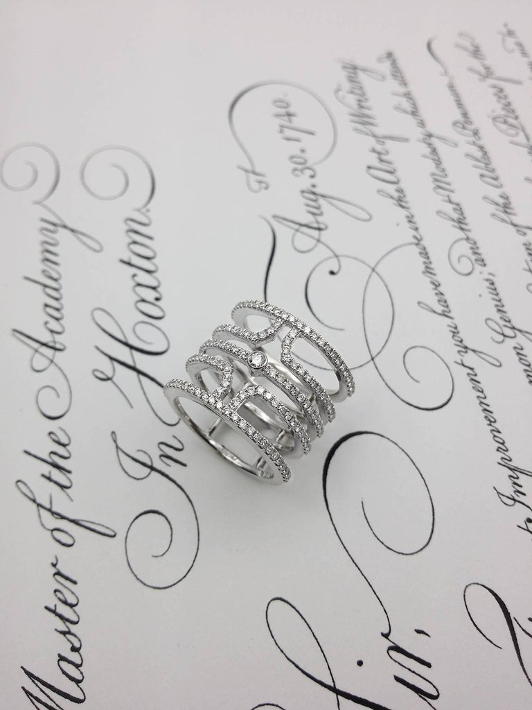 Multi row diamond fashion ring, features 1.00 carat of colorless white diamonds.  The ring size is 6